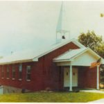 This picture was taken in the 1980's.  In 1962 the church moved about two blocks north of Elston, after trading for a two-acre tract and erected the present building.  A 28' X 54' brick veneer structure with facilities in the basement was erected.